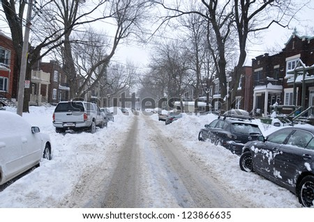 MONTREAL-CANADA DEC. 27:Cars cover of snow on Merose Street. The snow storm slam Montreal with 45 cm of snow, Canada on December 27, 2012 after knocking out power to thousands of homes in the U.S.. - stock photo