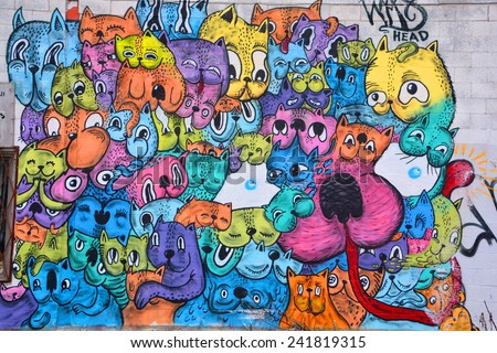 MONTREAL CANADA DEC 27: Street art Montreal alien gosts on dec 27 2014 in Montreal Canada. Montreal. is the perfect place to walk in the back alleys and abandoned areas, looking for street art. - stock photo