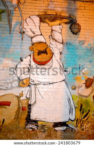 MONTREAL CANADA DEC 27: Street art Montreal chef on dec 27 2014 in Montreal Canada. Montreal. is the perfect place to walk in the back alleys and abandoned areas, looking for fresh air and street art. - stock photo