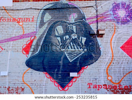 MONTREAL CANADA DEC 02: Street art Montreal Darth Vador on dec 02 2014 in Montreal Canada. Montreal. is the perfect place to walk in the back alleys and abandoned areas, looking for street art. - stock photo