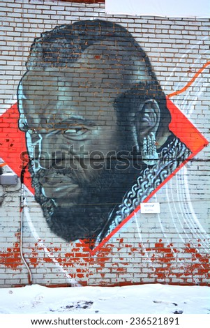 MONTREAL CANADA DEC 02: Street art Montreal MR T on dec 02 2014 in Montreal Canada. Montreal. is the perfect place to walk in the back alleys and abandoned areas, looking for fresh air and street art. - stock photo
