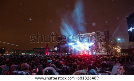 MONTREAL, CANADA - DECEMBER 31, 2016: MERRY MONTREAL - The Coca-Cola New Year's Party under the snow in the old port of Montreal, Quebec, Canada