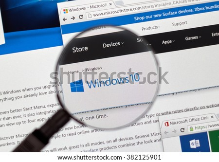 MONTREAL, CANADA - FEBRUARY, 2016 - Microsoft Windows on the web under magnifying glass. - stock photo