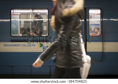 Montreal, Canada - January 26, 2016: Passengers leaving the subway platform as the train is departing on the Montreal Metro station of Montmorency