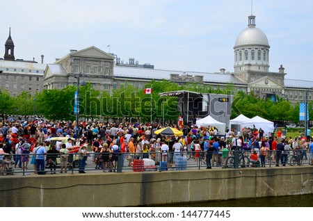 MONTREAL CANADA JULY 01: Crowd during Canada Day celebration in Old port of Montreal on july 01 2013 in Montreal Canada - stock photo
