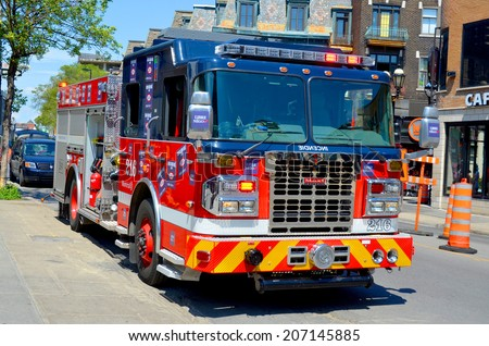 MONTREAL CANADA JULY 18: Fire engine on july 18 2014 in Montreal Canada. Service de securite incendie de Montreal the SIM is the 7th largest fire department in North America.