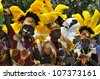 MONTREAL - CANADA JULY 07: Unidentified Participants at the Montreal Carifiesta Montreal Carifte parade on July 07, 2012. Montreal's Caribbean community, carnival style, with beautiful costumes - stock photo