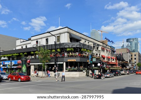 MONTREAL, CANADA - JUN 13, 2015: The corner of Crescent Street and De Maisonneuve Boulevard.  Crescent St is a very popular area containing many trendy shops, bars, nightclubs and restaurant.   - stock photo