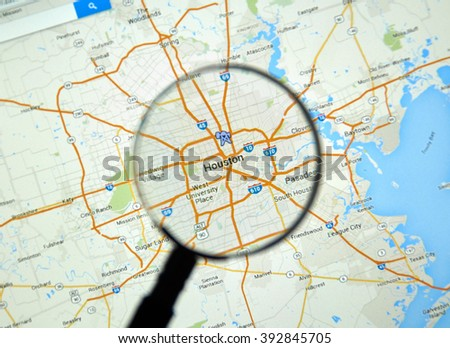 MONTREAL, CANADA - MARCH 17, 2016 -  Houston on Google Maps app under magnifying glass.