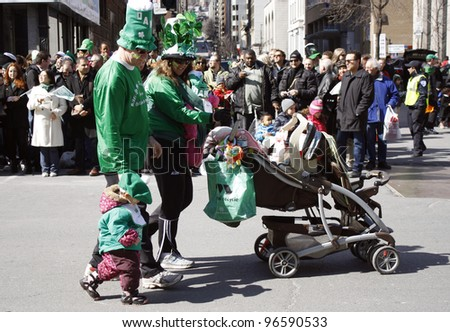 MONTREAL, CANADA - MARCH 20: participants of parade at the St. Patrick's Day Parade on March 20, 2011 in Montreal, Canada. It's a traditional Irish holiday parade. - stock photo