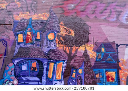 MONTREAL CANADA MARCH 08: Street art Montreal haunted house on march 08 2015 in Montreal Canada. Montreal. is the perfect place to walk in the back alleys and abandoned areas, looking for street art. - stock photo