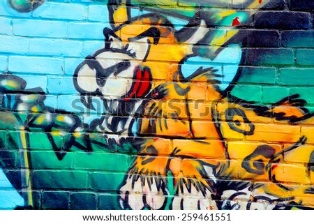 MONTREAL CANADA MARCH 08: Street art Montreal tiger on march 08 2015 in Montreal Canada. Montreal. is the perfect place to walk in the back alleys and abandoned areas, looking for street art. - stock photo