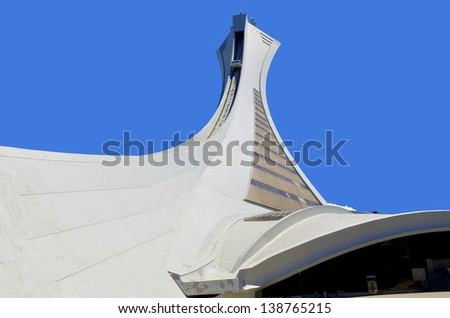 MONTREAL,CANADA -MAY.5.The Montreal Olympic Stadium and tower on may 5 , 2013. It's the tallest inclined tower in the world.Tour Olympique stands 175 meters tall and at a 45-degree angle - stock photo