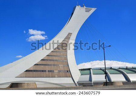 MONTREAL CANADA MAY 15: The Montreal Olympic Stadium and tower on May 15 2013. It's the tallest inclined tower in the world.Tour Olympique stands 175 meters tall and at a 45-degree angle