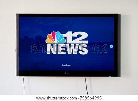 lg tv logo. montreal, canada - november 15, 2017: 12 news broadcasting app and logo on lg tv