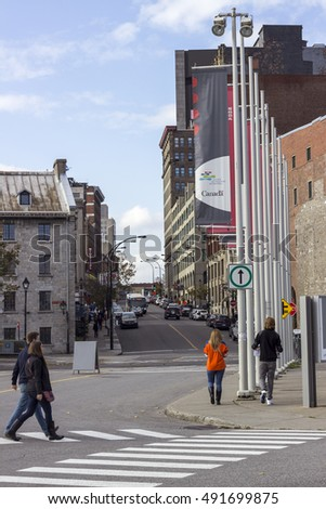 MONTREAL, CANADA - OCTOBER 20, 2014 - People walking in the old part of Montreal during Fall