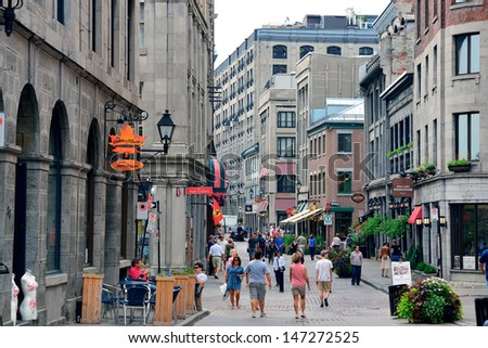MONTREAL, CANADA - SEP 8: City old street view on September 8, 2012 in Montreal, Canada. It is the largest city in Quebec, the second-largest in Canada and the 15th-largest in North America. - stock photo
