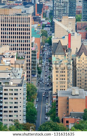 MONTREAL, CANADA - SEP 8: City street aerial view on September 8, 2012 in Montreal, Canada. It is the largest city in Quebec, the second-largest in Canada and the 15th-largest in North America. - stock photo