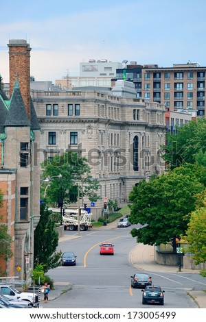 MONTREAL, CANADA - SEP 8: City street view with busy traffic on September 8, 2012 in Montreal, Canada. It is the largest city in Quebec, the 2nd-largest in Canada and the 15th-largest in North America - stock photo