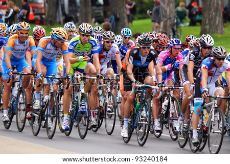MONTREAL, CANADA-SEPTEMBER 11: A group of cyclists in action at 2011 UCI cycling calendar | 2011 Grand Prix Cycliste de Montréal on September 11, 2011 in Montreal, Mount royal climb - stock photo