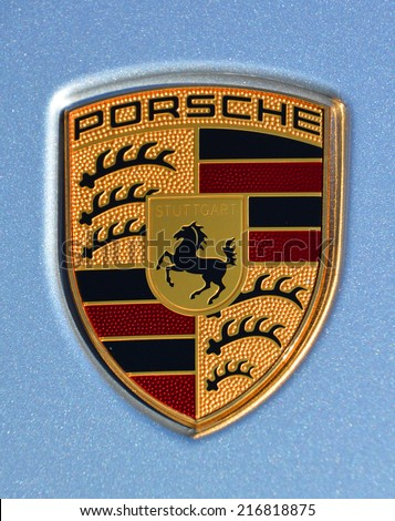 MONTREAL CANADA SEPTEMBER 02 2014: Porsche emblem on blue background. Ferdinand Porsche founded the company in 1931 with main offices in the center of Stuttgart. - stock photo