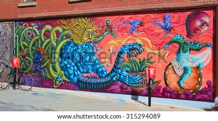 MONTREAL CANADA SEPTEMBER 4 2015: Street art alien circus . Montreal is the perfect place to walk in the back alleys and abandoned areas, looking for street art.