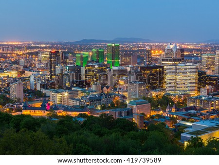 MONTREAL, CANADA - 18TH MAY 2015: A view of the Montreal Skyline at Dusk showing various buildings in the city - stock photo