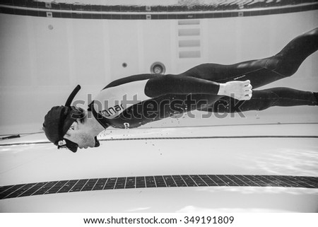 MONTREAL, CIRCA JUNE 2014 - Two Hot Spring Days of Freediving Competition at Jean-Drapeau 50m Outdoor Olympic Pool. Dynamic no Fins Freediver during Performance from Underwater