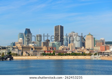 Montreal city skyline over river in the day with urban buildings - stock photo