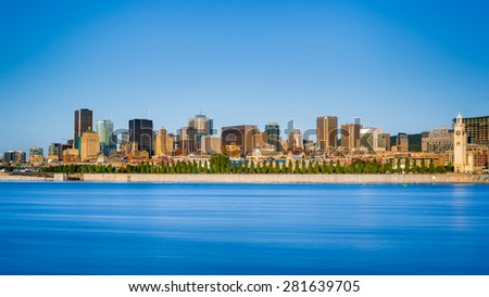 Montreal city skyline over Saint Lawrence River in the morning with urban buildings, Montreal, Quebec, Canada - stock photo
