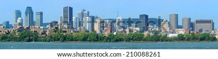 Montreal city skyline panorama over river in the day with urban buildings - stock photo