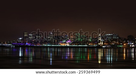Montreal downtown in night with reflection in water - stock photo