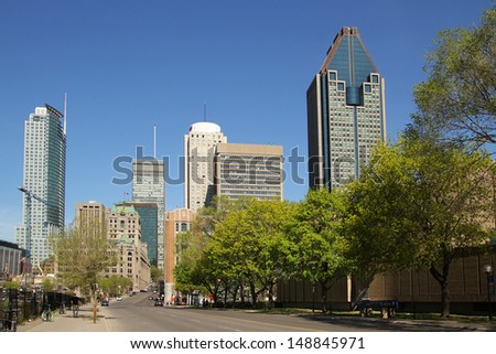 Montreal downtown with trees by a nice summer day - stock photo