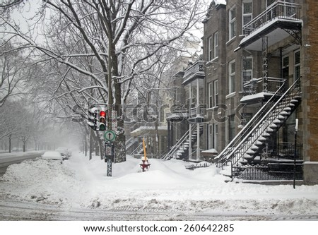 Montreal famous neighborhood  in a snowstorm - stock photo