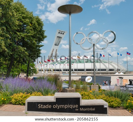 MONTREAL - JULY 18:The Olympic Stadium in Montreal,Canada on july 18,2014.Built in the mid-1970s as the main venue for the 1976 Summer Olympics it is the largest by seating capacity (65255) in Canada. - stock photo