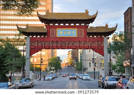 MONTREAL - JUN 8: Chinatown Gateway at the entrance of Montreal Chinatown at Boulvard St-Laurent on June 8, 2012 in Montreal, Quebec, Canada. - stock photo