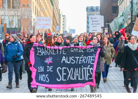 MONTREAL - MARCH 29: A procession fills a street in Montreal during a rally organized by women's rights groups who oppose Quebec's Bill 20, which would limit access to abortions. - stock photo