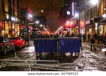 MONTREAL - MARCH 27: Barricades are erected on a street in Montreal's shopping district during an aggressive student protest. - stock photo