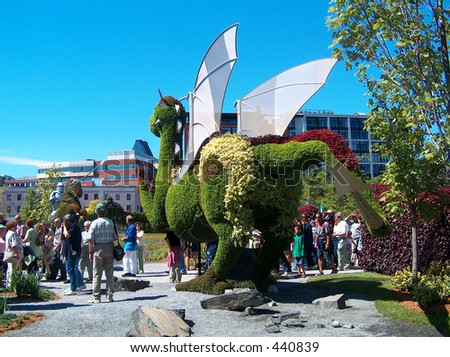 Montreal Mosaiculture 2003 Flower Sculptures Dragon & Knight - stock photo
