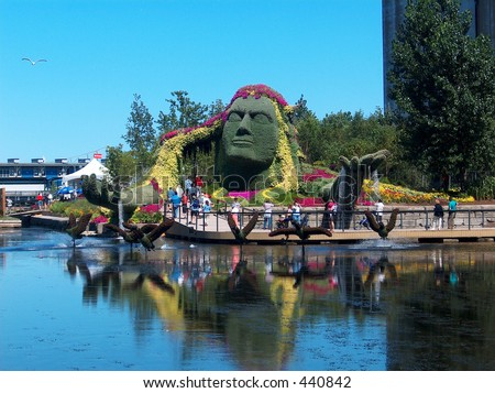 Montreal Mosaiculture 2003 Flower Sculptures Mother Earth - stock photo