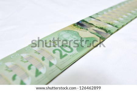 MONTREAL - NOVEMBER 19: The new polymer twenty dollar bill, which is the most widely used bank note in the country, is pictured on November 19, 2012 in Montreal, Quebec, Canada. - stock photo