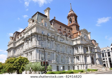 Montreal Old City Hall after restoration. The green roof is replaced by a new bronze roof. - stock photo