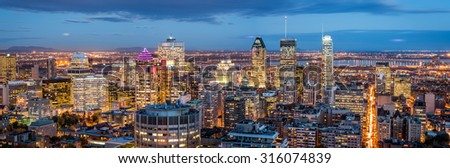 Montreal panorama at dusk as viewed from the Mount Royal overlook - stock photo