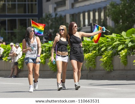 MONTREAL, QC - AUG 19, 2012: Gay and lesbians walk in the Gay Pride Parade in Montreal, QC on Aug 19, 2012. - stock photo