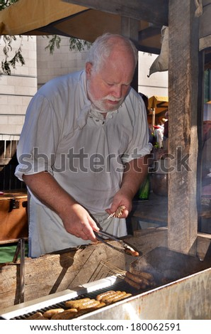 MONTREAL QUEBEC CANADA AUGUST 24: Man as cooks re-enacting New France period in Old Montreal, Pointe-a-Calliere's 18th Century Public Market on august 24 2013 in Montreal Canada - stock photo