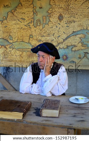 MONTREAL QUEBEC CANADA AUGUST 24: Man re-enacting New France period in Old Montreal, Pointe-a-Calliere's 18th Century Public Market on august 24 2013 in Montreal Canada - stock photo
