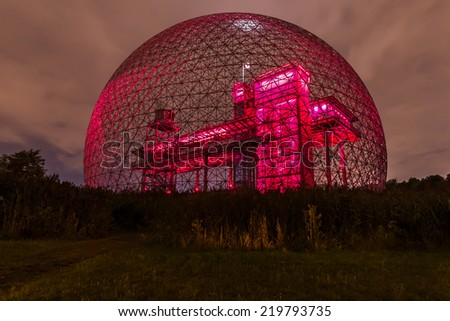 Montreal,Quebec,Canada-August 22-2012 Metallic Structure of Biosphere of Montreal This structure was in 1967 the Pavilion from the United States has the Montreal International Exhibition Red. - stock photo