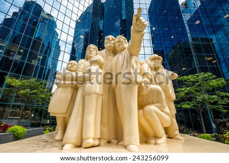 Montreal,Quebec,Canada- August-16-2012: The Illuminated Crowd is a public sculpture, made in 1985 by artist Raymond Mason from stratified polyester resin with polyurethane paint. - stock photo