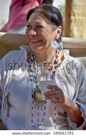 MONTREAL QUEBEC CANADA AUGUST 24: Woman wears as indian re-enacting New France period in Old Montreal, Pointe-a-Calliere's 18th Century Public Market on august 24 2013 in Montreal Canada - stock photo