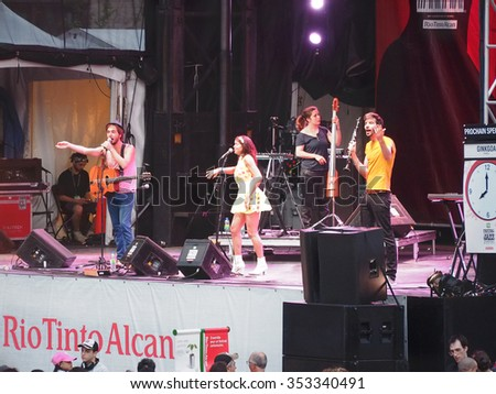 Montreal Quebec Canada - July 4 2015 - Ginkgoa from France concert Jazz International Festival . Swing Pop-Art music  Boston guitarist ,  French singer, female bass guitar,  electric clarinet . - stock photo